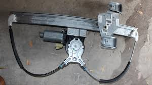 electric window regulator with motor attached
